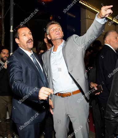 """Stock Image of Adam Sandler, Keith Williams Richards. Actors Adam Sandler, left, and Keith Williams Richards attend a premiere for """"Uncut Gems"""" on day five of the Toronto International Film Festival at the Princess of Wales Theatre, in Toronto"""