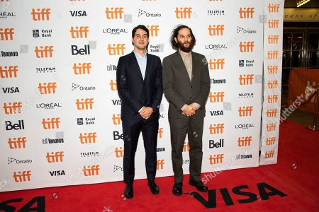 """Benny Safdie, Josh Safdie. Writer/director/editor Benny Safdie, left, and writer/director Josh Safdie attend a premiere for """"Uncut Gems"""" on day five of the Toronto International Film Festival at the Princess of Wales Theatre, in Toronto"""