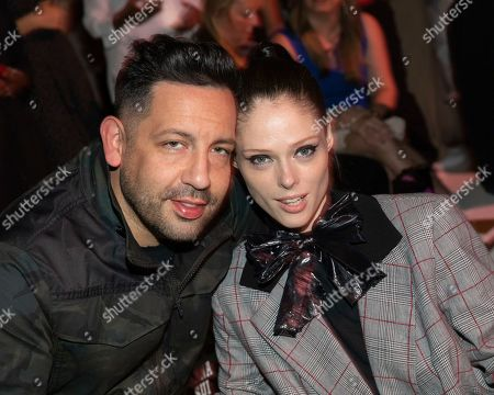 James Conran, Coco Rocha. James Conran, left, and Coco Rocha attend the Anna Sui runway show at Spring Studios during NYFW Spring/Summer 2020, in New York