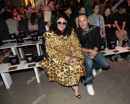 Ashley Longshore, guest. Ashley Longshore, left, and guest attend the Anna Sui runway show at Spring Studios during NYFW Spring/Summer 2020, in New York