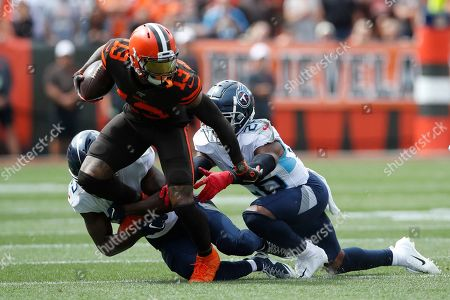 Odell Beckham, Adoree' Jackson, Logan Ryan. Cleveland Browns wide receiver Odell Beckham (13) tries to split the defenders of the Tennessee Titans, cornerback Adoree' Jackson (25) and cornerback Logan Ryan (26) during an NFL football game, in Cleveland