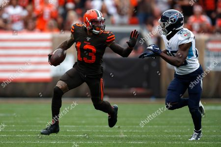 Stock Photo of Odell Beckham, Adoree' Jackson. Cleveland Browns wide receiver Odell Beckham (13) tries to avoid Tennessee Titans cornerback Adoree' Jackson (25) during an NFL football game against the Tennessee Titans, in Cleveland