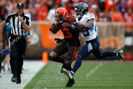 Odell Beckham, Adoree' Jackson. Cleveland Browns wide receiver Odell Beckham (13) tries to avoid Tennessee Titans cornerback Adoree' Jackson (25) during an NFL football game against the Tennessee Titans, in Cleveland
