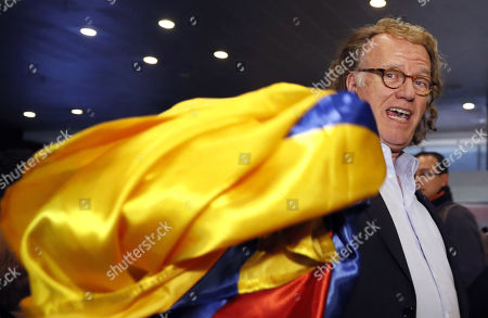 Dutch violinist Andre Rieu waves a Colombian flag and smiles upon his arrival at the El Dorado International Airport in Bogota, Colombia, 09 September 2019. The conductor and founder of the Johann Strauss Orchestra will hold concerts in Bogota from 12 to 15 September 2019.