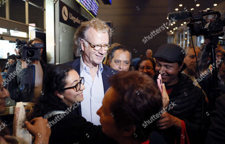 Colombian fans greet Dutch violinist Andre Rieu (C) upon his arrival at the El Dorado International Airport in Bogota, Colombia, 09 September 2019. The conductor and founder of the Johann Strauss Orchestra will hold concerts in Bogota from 12 to 15 September 2019.