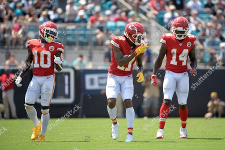 Kansas City Chiefs wide receiver Tyreek Hill (10), wide receiver Demarcus Robinson (11) and wide receiver Sammy Watkins (14) set up for a play during the first half of an NFL football game against the Jacksonville Jaguars, in Jacksonville, Fla