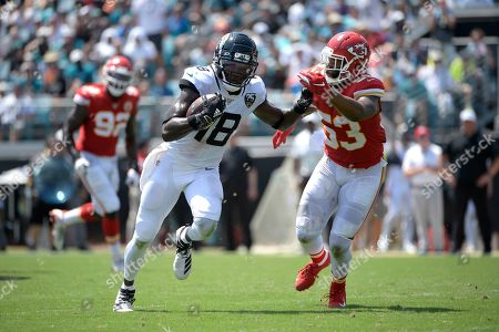 Jacksonville Jaguars wide receiver Chris Conley (18) runs after catching a pass in front of Kansas City Chiefs inside linebacker Anthony Hitchens (53) during the first half of an NFL football game, in Jacksonville, Fla