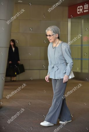 Japan's former Empress Michiko, who underwent successful surgery to remove cancer in her left breast on Sept. 8, leaves the University of Tokyo Hospital in Tokyo