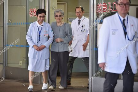 Japan's former empress Michiko, second left, who underwent successful surgery to remove cancer in her left breast on Sept. 8, leaves the University of Tokyo Hospital in Tokyo