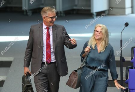 Co-chairman of German Left party Dietmar Bartsch (L) and Kirsten Kappert-Gonther (R) of the federal Alliance 90/The Greens party talk during a session of the German parliament 'Bundestag' in Berlin, Germany, 10 September 2019. Cem Oezdemir, former federal chairman of the Greens, and Kirsten Kappert-Gonther will candidate on 24 September 2019 for the Greens Bundestag faction chair.