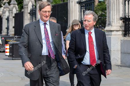 MP for Beaconsfield Dominic Grieve and MP for West Dorset Oliver Letwin walk outside The Houses of Parliament.