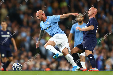 Nicky Butt of Premier League All-Stars tackles Stephen Ireland of Manchester City Legends