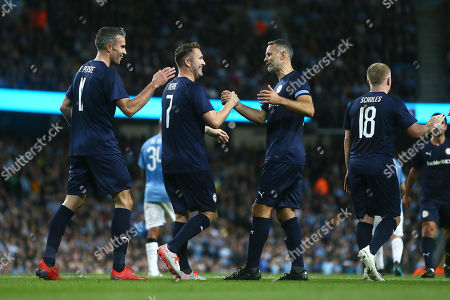 Robbie Keane of Premier League All-Stars celebrates scoring his sides first goal with Robin van Persie and Ryan Giggs