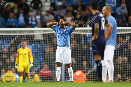 Stock Photo of Joleon Lescott of Manchester City Legends jokingly gestures crying to his opposition