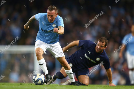 Craig Bellamy of Manchester City Legends and Rafael van der Vaart of Premier League All-Stars