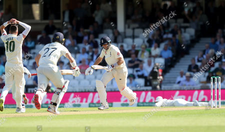 England's Joe Root (Captain) makes runs after he   is dropped for a third time by Steve Smith of Australia (R) - Peter Siddle of Australia is frustrated (L)