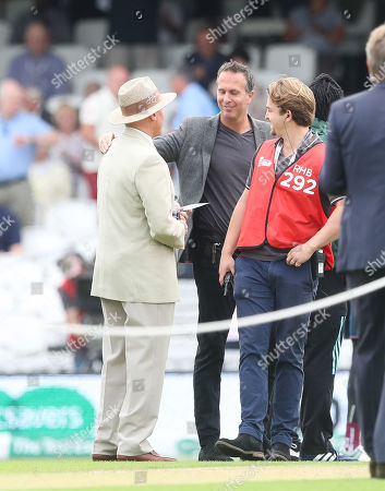 Stock Picture of Sir Geoffrey Boycott  gets a friendly embrace from Michael Vaughan