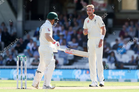 England's Stuart Broad stares at David Warner of Australia after nearly getting an edge