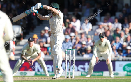 Steve Smith of Australia edges and  is dropped by England's Joe Root (Captain - R)
