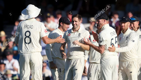 England's Chris Woakes celebrates (3rd L no cap) after taking the wicket of Steve Smith of Australia is out LBW for 80 runs