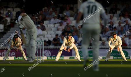 Australia's slip cordon (Steve Smith of Australia centre - David Warner of Australia R) field in the last strip of September sunlight as England begin their second innings