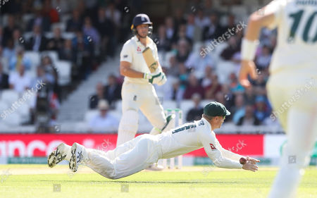 David Warner of Australia dives but can't stop a shot from England's Jos Buttler