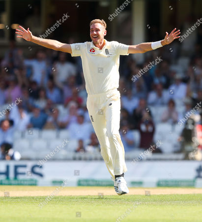 England's Stuart Broad celebrates the wicket of Steve Smith of Australia out for 23 runs caught England's Ben Stoke