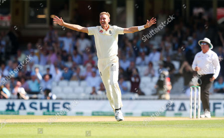 England's Stuart Broad celebrates the wicket of Steve Smith of Australia out for 23 runs caught England's Ben Stokes