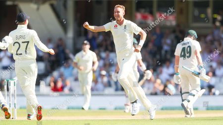 England's Stuart Broad celebrates the wicket of Steve Smith of Australia (R) out for 23 runs caught England's Ben Stokes