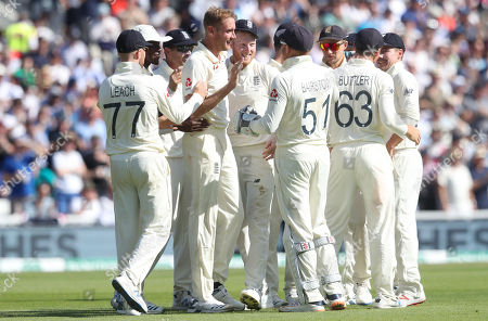 England's Stuart Broad (4th L) celebrates the wicket of Steve Smith of Australia out for 23 runs caught England's Ben Stokes (5th L)