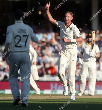 England's Stuart Broad celebrates the wicket of Pat Cummins of Australia out for 9 runs