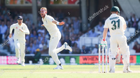 England's Stuart Broad celebrates the wicket of  David Warner of Australia (R) caught Burns out for 11 runs