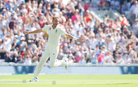 England's Stuart Broad celebrates the wicket of  David Warner of Australia caught Burns out for 11 runs
