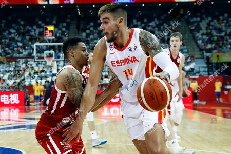 Willy Hernangomez Geuer (R) of Spain in action against A.J. Slaughter (L) of Poland during the FIBA Basketball World Cup 2019 quarter final? match between Spain and Poland in Shanghai, China, 10 September 2019.