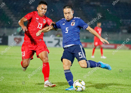 Myanmar's Kaung Si Thu (L) in action against Japanese player Yuto Nagatomo (R) during the FIFA World Cup 2022 qualifying group F soccer match between Myanmar and Japan at the Thuwanna Football Stadium in Yangon, Myanmar, 10 September 2019.