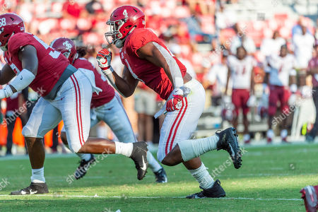New Mexico St Alabama Football. Alabama linebacker Christopher Allen (4) attacks against New Mexico State during the second half of an NCAA college football game, in Tuscaloosa, Ala