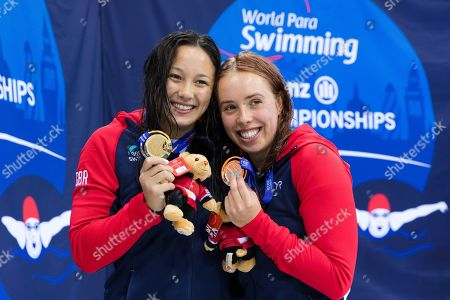 Alice Tai (L) and Megan Richter (R) of Britain pose for photos with their medals after the 100m Backstroke S8 final on day two of the World Para Swimming Championships held at the London Aquatics Centre in London, Britain, 10 September 2019. The event is one of the largest Para Swimming championships and will see nearly 600 swimmers compete from 09 September to 15 September 2019.