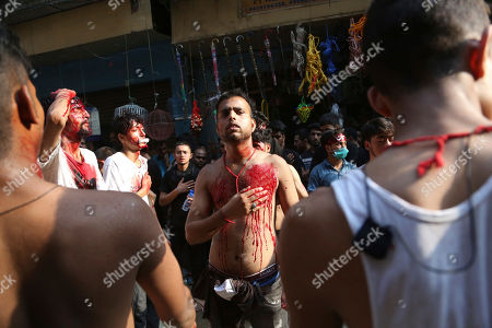 Indian Shiite Muslims flagellate themselves during a procession to mark Ashoura in Jammu, India, Tuesday, Sept.10, 2019. Ashoura, the tenth day of the lunar Islamic month of Muharram, is marked by Shiite believers as the day that Imam Hussein, the grandson of prophet Muhammad and one of their most revered saints, was killed in the battle of Karbala in the year 680 A.D