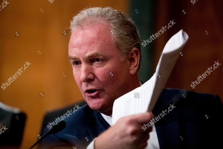 """Sen. Chris Van Hollen, D-Md., pictured, questions Housing and Urban Development Secretary Ben Carson as he appears before a Senate Banking Committee hearing on """"Housing Finance Reform: Next Steps"""" on Capitol Hill, in Washington. Trump administration officials appear before Congress to defend their plan for ending government control of Fannie Mae and Freddie Mac"""