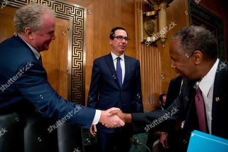 """Steven Mnuchin, Ben Carson, Chris Van Hollen. Treasury Secretary Steven Mnuchin, watches as Sen. Chris Van Hollen, D-Md., left, shakes hands with Housing and Urban Development Secretary Ben Carson, right, following a Senate Banking Committee hearing on """"Housing Finance Reform: Next Steps"""" on Capitol Hill, in Washington. Trump administration officials appear before Congress to defend their plan for ending government control of Fannie Mae and Freddie Mac"""