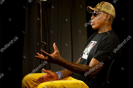 """Former basketball star Dennis Rodman gestures during an interview in Los Angeles. Rodman's spectacular personal highs and very public lows are the subject of the new ESPN """"30 For 30"""" documentary """"Dennis Rodman: For Better or Worse"""