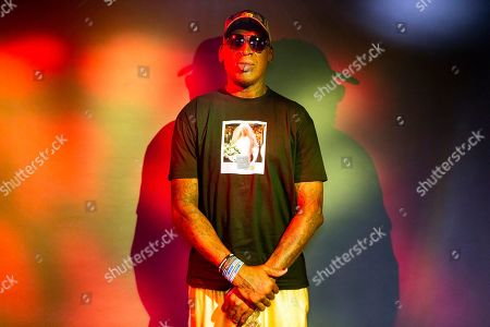 """Former basketball star Dennis Rodman poses wearing a T-shirt depicting himself in a wedding dress at a 1996 book promo event, in Los Angeles. The former NBA star, featured in a new ESPN documentary, weighs in on his personal brand, bisexual athletes, North Korea and Trump. Rodman's spectacular personal highs and very public lows are the subject of the new ESPN """"30 For 30"""" documentary """"Dennis Rodman: For Better or Worse"""