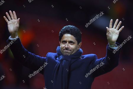 """Paris Saint Germain owner Nasser bin Ghanim Al-Khelaifi waves to teams fans at the end of their soccer match against Manchester United at Old Trafford stadium in Manchester, England. Under investigation in French and Swiss criminal investigations, the president of PSG has been praised as a """"tremendous professional"""" by his UEFA executive committee colleague Andrea Agnelli on Tuesday, Sept. 10. Nasser Al-Khelaifi and European Club Association chairman Agnelli have four-year terms to represent clubs on the European soccer body's ruling panel"""