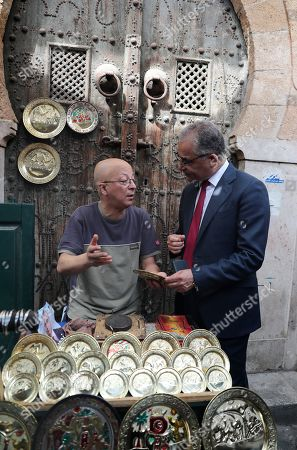 Stock Picture of The presidential candidate of 'Machrouu Tounes' party Mohsen Marzouk (R) talks with vendor during his electoral campaign in the old city of Tunis, Tunisia, 10 September 2019. The election campaign will run from 02 to 13 September. The first round of the presidential election in Tunisia will be held on 15 September.