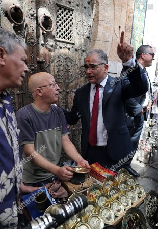 Stock Image of The presidential candidate of 'Machrouu Tounes' party Mohsen Marzouk (R) talks with vendor during his electoral campaign in the old city of Tunis, Tunisia, 10 September 2019. The election campaign will run from 02 to 13 September. The first round of the presidential election in Tunisia will be held on 15 September.