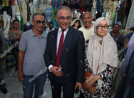 The presidential candidate of 'Machrouu Tounes' party Mohsen Marzouk (C) poses for a photograph as he visits the old city of Tunis, Tunisia, 10 September 2019. The election campaign will run from 02 to 13 September. The first round of the presidential election in Tunisia will be held on 15 September.
