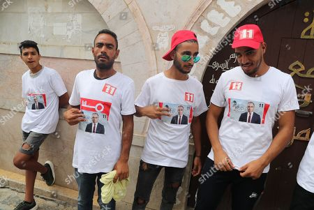 Stock Photo of Supporters of presidential candidate of 'Machrouu Tounes' party Mohsen Marzouk during his presidential electoral campaign in the old city of Tunis Tunisia, 10 September 2019. The election campaign will run from 02 to 13 September. The first round of the presidential election in Tunisia will be held on 15 September.