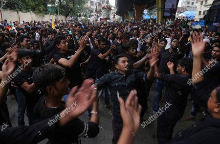 Indian Shiite Muslims beat their chest during a procession to mark Ashoura in Mumbai, Tuesday, Sept.10, 2019. Ashoura falls on the 10th day of Muharram, the first month of the Islamic calendar, when Shiites mark the death of Hussein, the grandson of the Prophet Muhammad, at the Battle of Karbala in present-day Iraq in the 7th century