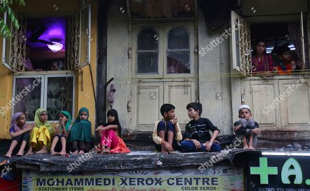 Muslim children watch an Ashoura procession in Mumbai, Tuesday, Sept.10, 2019. Ashoura falls on the 10th day of Muharram, the first month of the Islamic calendar, when Shiites mark the death of Hussein, the grandson of the Prophet Muhammad, at the Battle of Karbala in present-day Iraq in the 7th century