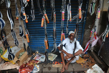 An Indian Muslim man waits to sell knifes used by Shiite Muslims to self flagellate during a procession to mark Ashoura in Mumbai, Tuesday, Sept.10, 2019. Ashoura falls on the 10th day of Muharram, the first month of the Islamic calendar, when Shiites mark the death of Hussein, the grandson of the Prophet Muhammad, at the Battle of Karbala in present-day Iraq in the 7th century